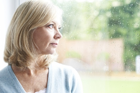 mature lady looking out of window
