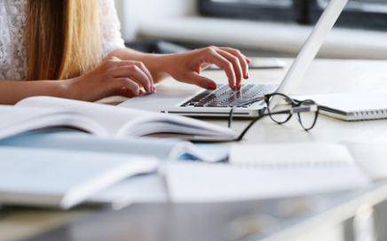 woman typing testimonial